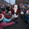 Newburyport: Santa makes his way through the crowd to for the annual parade and tree lighting in Newburyport Sunday. Jim Vaiknoras/staff photo