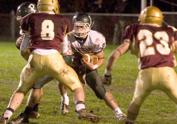 Newburyport: Pentucket's Cody Rothwell  looks for running room against Newburyport Friday night at World War Memorial Stadium in Newburyport. JIm Vaiknoras/staff photo