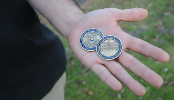 Newbury: Wounded Iraq and Afganistan veteran Donald Jarvis with coins given to him by President Obama and Vice President Biden. Jim Vaiknoras/staff photo