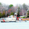 Newburyport: A Coast Guard  rescue boat searches the Merrimack River near Cashman Park for a man who is believed to have fallen of his boat earlier in the day. Jim Vaiknoras/staff photo