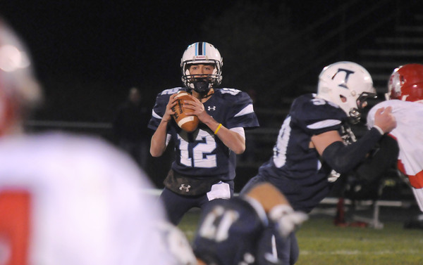 Byfield: Triton's Bradley Whitman looks for a reciever during the Vikings game against Saugus in Byfield Friday night. JIm Vaiknoras/staff photo
