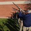 Amesbury: The firing squad cast long shadows at the city's annual Veteran's Day service at the Doughboy statue in Amesbury for . Jim Vaiknoras/staff photo