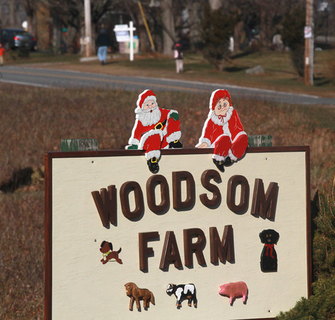 Amesbury: A Santa and Mrs Claus has been added to the dogs and farm animals on the sign for Woodsom Farm by someone with the holiday spirit. Jim Vaiknoras/staff photo