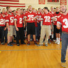 Amesbury: Perry Mzoz lead the football team in song at the Amesbury high Spirit Rally Wednesday in the Gym at the school. Jim Vaiknoras/staff photo