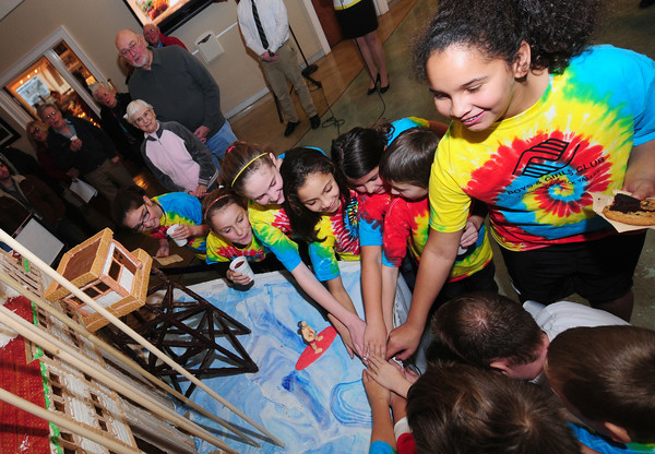 Salisbury: Children from the Lower Merrimack Valley Boys & Girls Club help flip the switch on the a Giant Ginger Bread House at the Pavilion on Salisbury BeachThursday night. Jim Vaiknoras/staff photo
