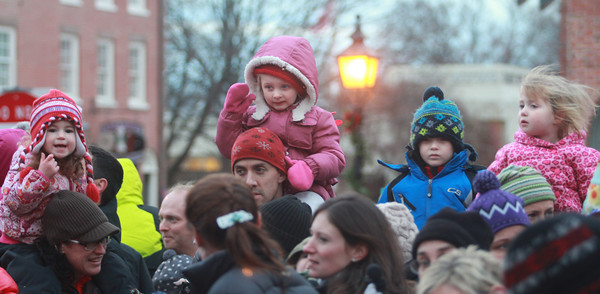 Newburyport: Kids perched high on parents shoulders try to see Santa at the annual parade and tree lighting in Newburyport Sunday. Jim Vaiknoras/staff photo