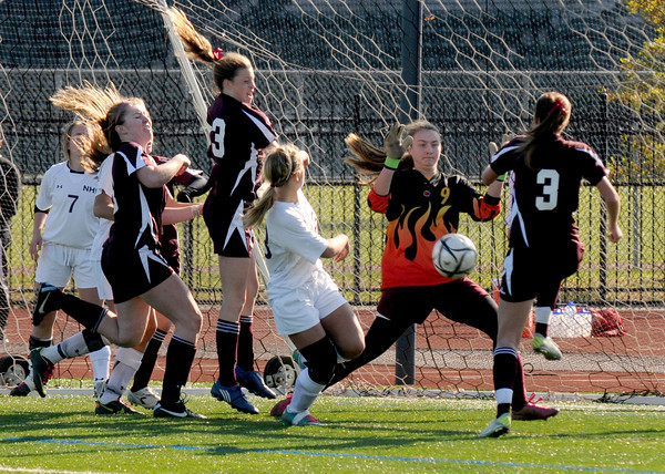 Lynn: Newburyport's Lilly Donovan makes a stop on a shot during the  Clippers1-0 overtime  loss to Belmont Saturday at Manning Field in Lynn. Jim Vaiknoras/staff photo