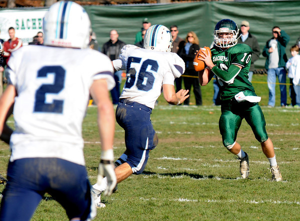 West Newbury: Pentucket's Mike Kutcher looks down field for a reciever during the Sachem's 41-12 victory over Triton. JIm Vaiknoras/staff photo
