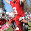 Amesbury: Amesbury's Perry Mzoz holds up teammate Pat Scanlon after team's their 13-10 victory against Newburyport Thursday. JIm Vaiknoras/staff photo
