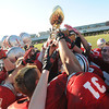Amesbury: Amesbury football players hold up the trophy after their 13-10 victory against Newburyport Thursday. JIm Vaiknoras/staff photo