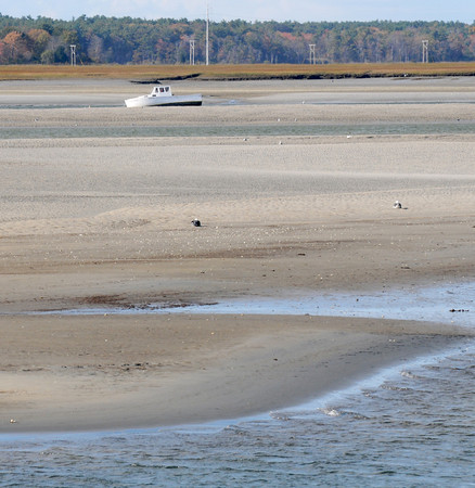 Seabrook: A boat rest on sand in the middle of Seabrook Harbor.Jim Vaiknoras/staff photo