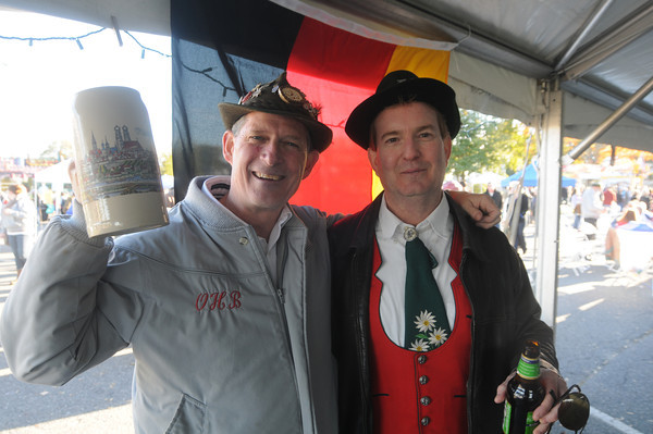 Newburyport: Dan Wells and Russ Ryan, players in The Oberlaendler Hofbrau Band, take a break from performing to grab a beer at the Oktoberfest at Cashman Park in Newburyport Saturday afternoon. Jim vAiknoras/staff photo