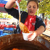 Amesbury:Jodi Basrowski, 10 serves up chili from the Lawrence General Hospital at the annual Amesbury Fire Fighters Chili Cook-Off  at the Millyard Parking lot in Amesbury Saturday. JIm Vaiknoras/staff photo