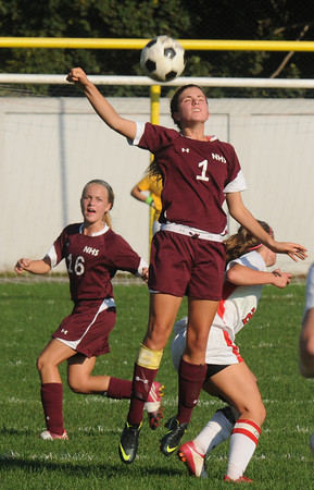 Amesbury: Newburyport's Alyssa Leahy goes up for a header against Amesbury during their game at Landry Stadium in Amesbury Friday. Jim Vaiknoras/staff photo