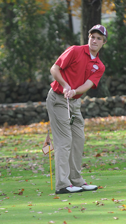 Rowley: Brendan Crowther a member of the Newburyport Golf Team practices his putting at Rowley Country Club Saturday. Jim Vaiknoras/staff photo