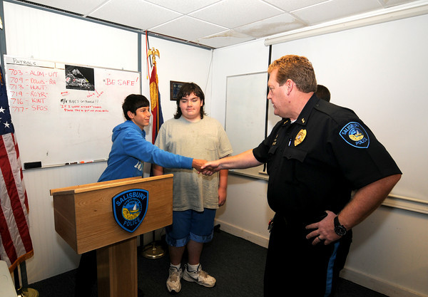 Salisbury: Mike Grella and Joshua Smith of the Merrimack Special Education persent a podium they build to Salisbury Police Chief Thomas Fowler at the station Friday. Jim Vaiknoras/staff photo