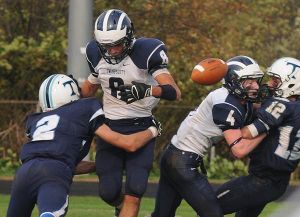 Byfield: Triton's Jake Gilbert knocks the ball away from Swampscott's Aaron Cronin during their game Saturday in Byfield. Jim Vaiknoras/staff photo