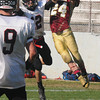 Newburyport: Newburyport's Ian Michaels breaks up a pass intended for  Mablehead's Brian Daly during their game at War Memorial Stadium in Newburyport Friday afternoon. Jim Vaiknoras/staff photo
