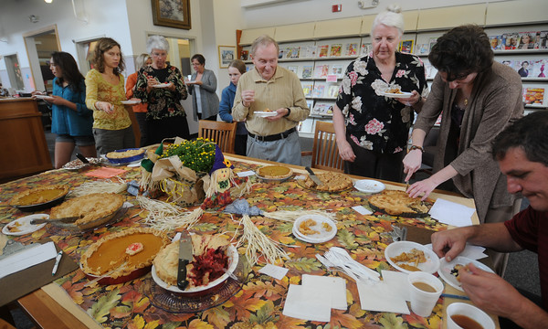 Byfield: Pie judges and pie lovers enjoy entries in the pie contest at The Newbury Town Library First Annual Fall Festival. Jim Vaiknoras/staff photo