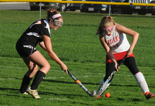 Amesbury: Amesbury's Autumn Klingerman fights for the ball with Ipswich's Brittney Potter during their game at Amesbury High Friday afternoon. Jim Vaiknoras/staff photo