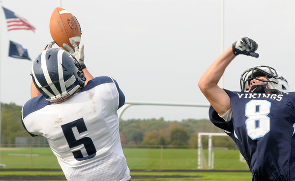 Byfield: Swampscott's Robert Serino makes a juggling catch of a ball just out of the reach of  Triton's Justin Spillane during their game Saturday in Byfield. Jim Vaiknoras/staff photo