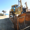 Newbury: A bulldozer sits at Plum Island beach center Thursday. JIm Vaiknoras/staff photo
