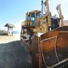 Newbury: A bulldozer sits at Plum Island beach center Thursday. JIm Vaiknoras/staff photo