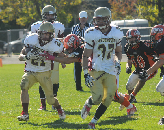 Ipswich: Newburyport's Tyler Cusack breaks a tackle during the Clippers game against Ipswich at Ipswich high Saturday. Jim Vaiknoras/staff photo
