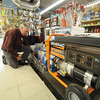 Neburyport: Roger Schaeffer an employee at Kelly's hardware store in Newburyport puts out batteries and sumppumps in anticipation of Hurricane Sandy  which in expected to hit early next week. Jim Vaiknoras/staff photo