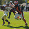 Ipswich: Ipswich's Michael Prine-Robie makes a stop in the back field on Newburyport's Drew Bourdeau during Tiger's home game against Newburyport Saturday morning. Jim Vaiknoras/staff photo