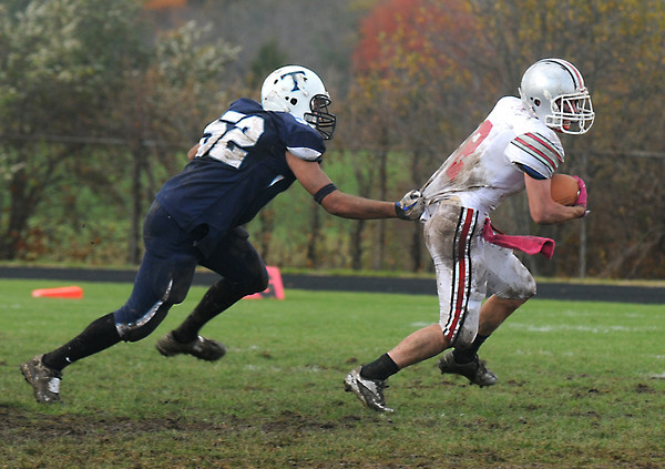 Byfield: Triton's Mark Landry hold on to Amesbury's Tommy Connors by his jersy during their gam at Triton Saturday afternoon. Jim Vaiknoras/staff photo
