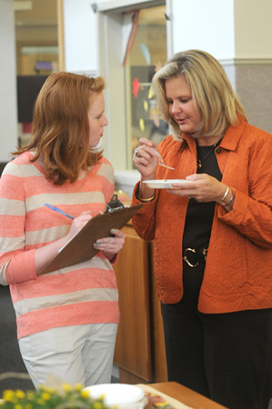 Byfield: Leanne Durkin , 15 and her mom Tracy Blais judge pies for the pie contest at The Newbury Town Library First Annual Fall Festival. Jim Vaiknoras/staff photo