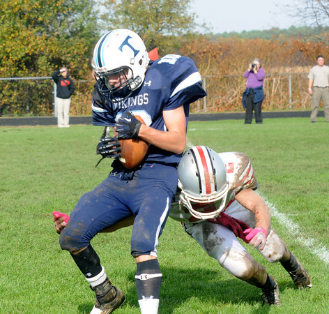 Byfield: Triton's Jack Germinara hauls in a pass as he it hit by an Amesbury defender during their game at Triton Saturday afternoon. Jim Vaiknoras/staff photo