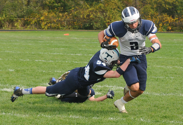 Byfield: Swampscott's Josh Rothwell breaks a tackle against Triton during their game Saturday in Byfield. Jim Vaiknoras/staff photo