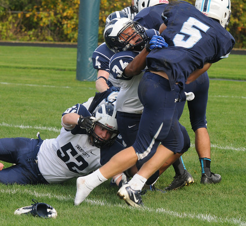 Byfield: Triton's Justin Spillane loses a shoe as he breaks tackles on his way to a touchdown against Swampscott Saturday in Byfield. Jim Vaiknoras/staff photo