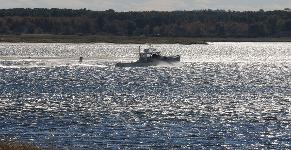 Newburyport: A fishing boat heads home up the Merrimack River towards Joppa in high winds and bright sunshine Thursday afternoon. Jim Vaiknoras/staff photo