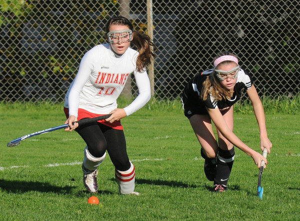 Amesbury: Amesbury's Dylan Masi fights for the ball with Ipswich's Samantha Solimero during their game at Amesbury High Friday afternoon. Jim Vaiknoras/staff photo