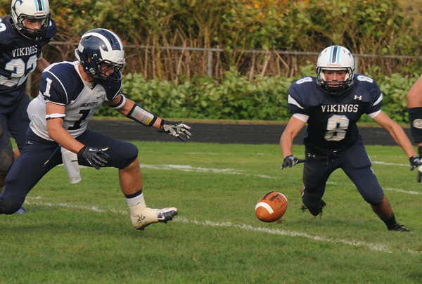 Byfield: Triton's Nicholas Desrocher beats Swampscott's Corey Carmody to a fumble during their game Saturday in Byfield. Jim Vaiknoras/staff photo