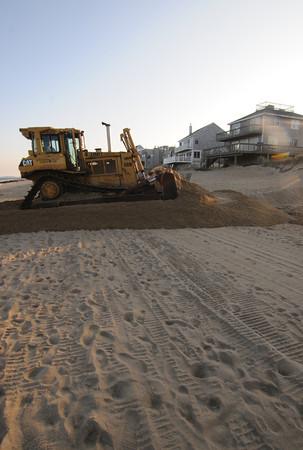 Newbury; A large bulldozer begins beach scraping on Plum Island Friday afternoon. Jim Vaiknoras/staff phoo