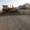 Newbury; A large bulldozer begins beach scraping on Plum Island Friday afternoon. Jim Vaiknoras/staff phoo