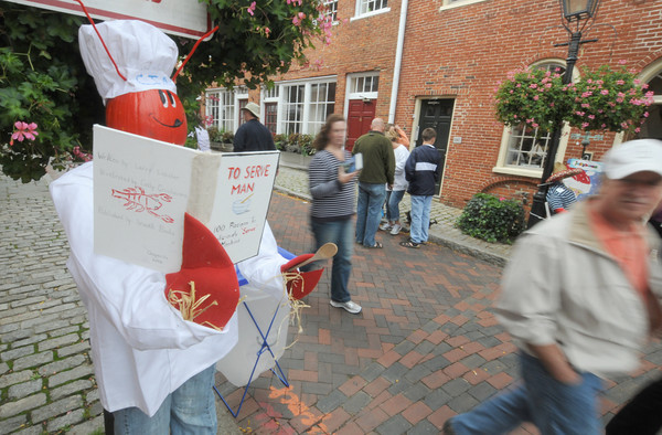 Newburyport: A lobster themed scare crow, with a clever nod to the Twilight Zone greets visitors on Inn Street at teh annual Harvest Festival in Newburyport. Jim Vaiknoras/staff photo
