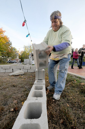 "Amesbury: Joan MacPherson lays a cider block on a temporary shelter at the Main Street Church in Amesbury. The church held ""Help Us Build for Haiti""  Fundraiser to raise money for a mission to Haiti in April. Jim Vaiknoras/staff photo"