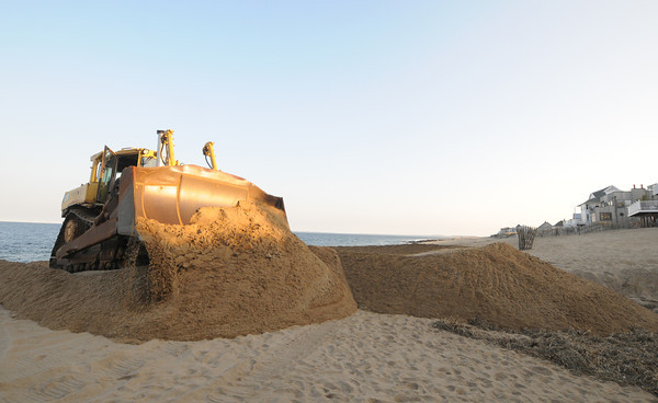 Newbury: A large bulldozer begins beach scraping on Plum Island Friday afternoon. Jim Vaiknoras/staff phoo