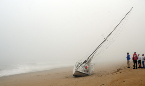 Newbury: TowBoat/US examine a sailboat Saturday morning that beached on Plum Island Friday night. JIm Vaiknoras/staff photo