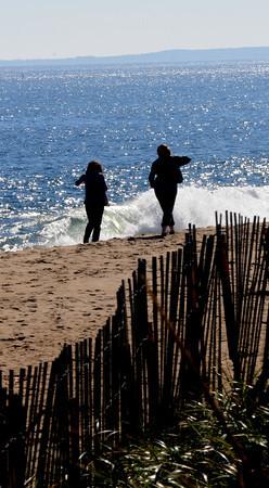 Newbury: Two women walk along a sunny Plum Island Beach Thursday afternoon. Jim Vaiknoras/staff photo