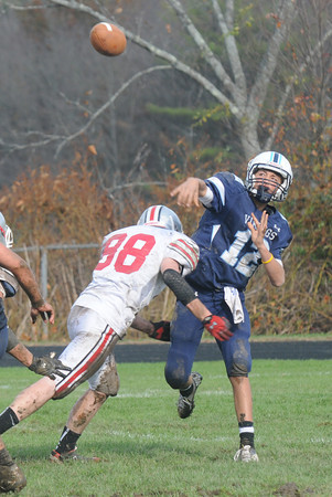Byfield: Triton's Bradley Whitman lets a pass go as Amesbury's Shawn Bannon bears down on him during their game at Triton Saturday afternoon. Jim Vaiknoras/staff photo