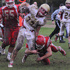 Saugus: Newburyport's Samual Francis breaks a tackle during the Clippers game at Saugus Friday afternoon. JIm Vaiknoras/staff photo