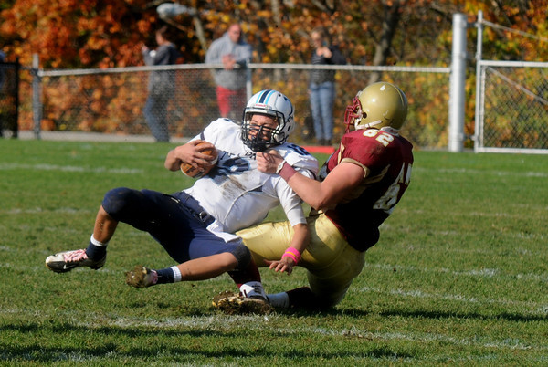 newburyport: Newburyport's Alexander Bickley sacks Triton's Bradley Whitman during their game Saturday at Newburyport. Jim Vaiknoras/staff photo