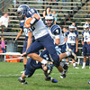 Byfield: Swampscott's Brian Santry pick up a few yards against Triton during their game Saturday in Byfield. Jim Vaiknoras/staff photo