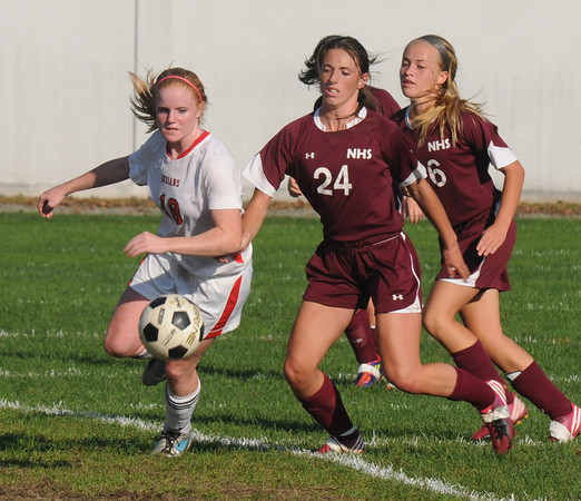 Amesbury: Amesbury's Hannah Zannini fight for the ball with Newburyport's Katherine Gorenflo during their game at Landry Stadium in Amesbury Friday. Jim Vaiknoras/staff photo